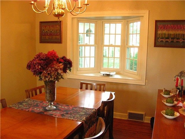 double hung windows and vase